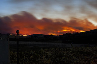 Bushfire in Tasmania, 2013. Image by Toni Fish http://www.flickr.com/photos/the_smileyfish/8348629576/ licensed under Creative Commons 2.0